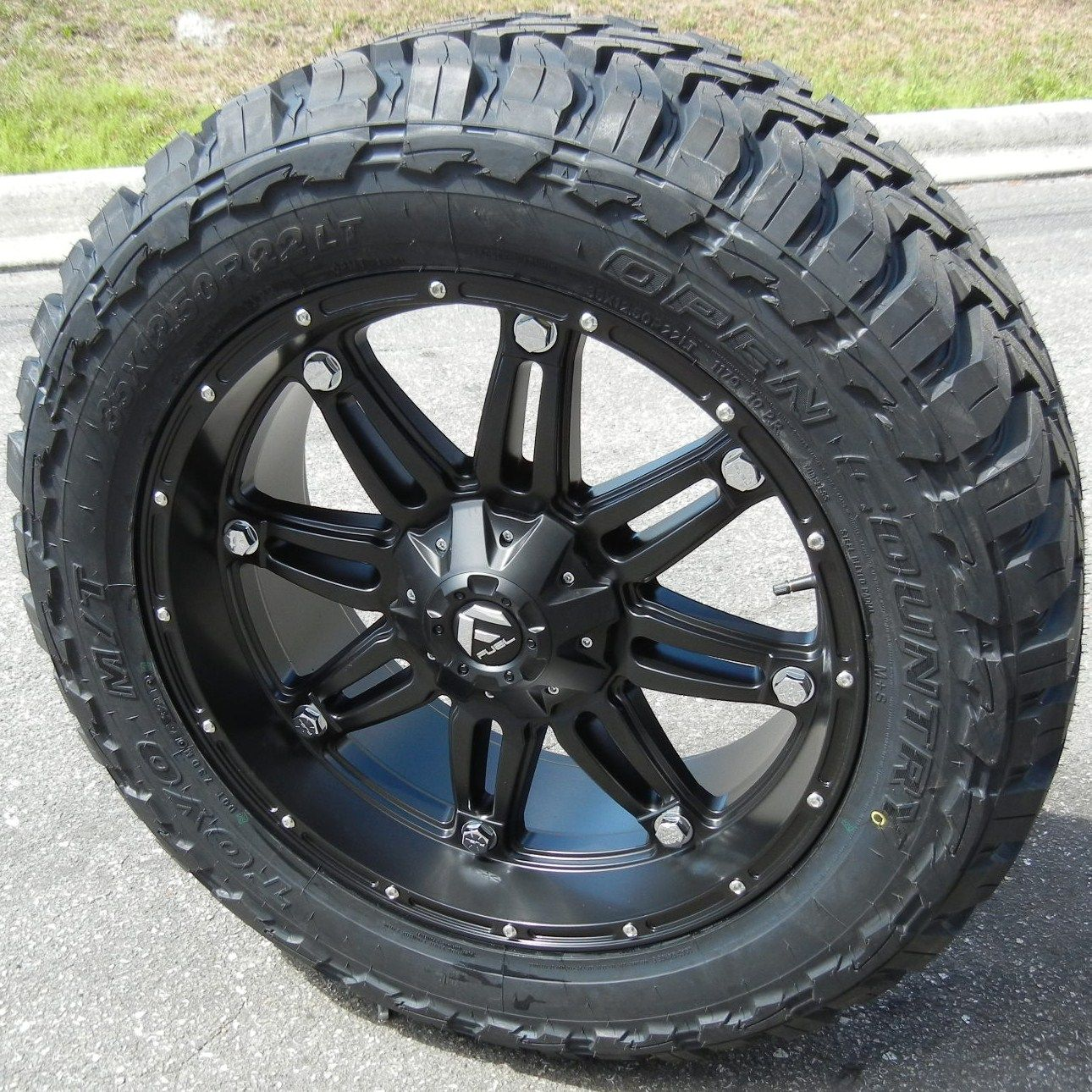 20 Black Fuel Hostage Wheels Toyo Open Country MT Chevy Silverado GMC